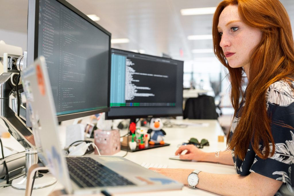 Woman working with remote IT computer support